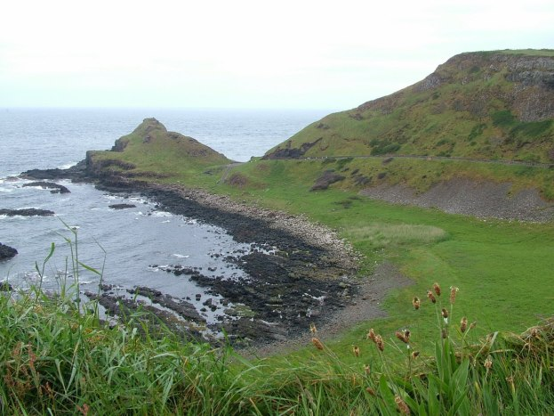 An image of the green fields along the shoreline at the Giant's Causeway in Northern Ireland. Photography by Frame To Frame - Bob and Jean.