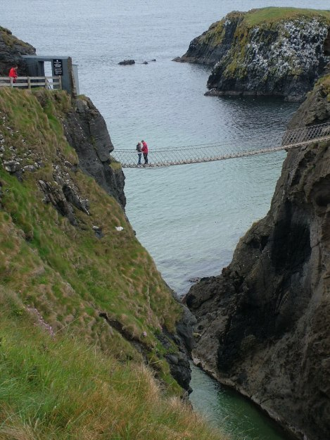 An image of people standing on the rope bridge at Carrick-a-Rede Island, Northern Island