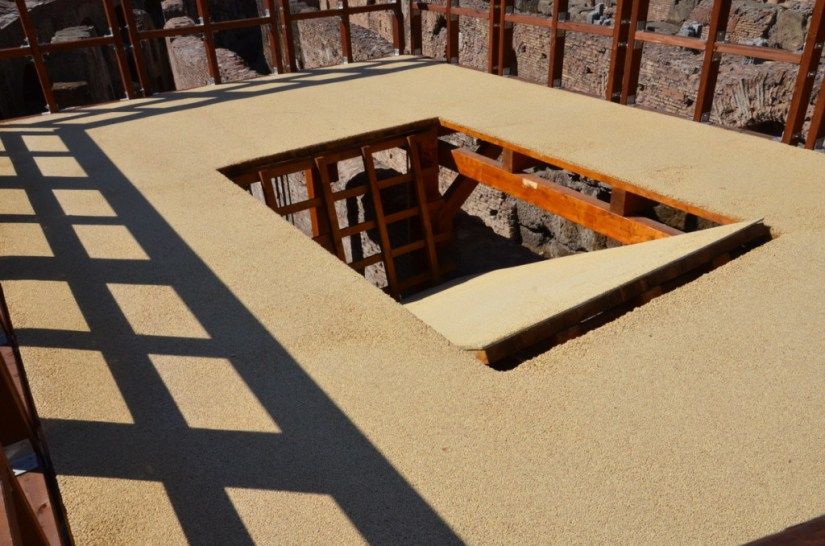 An image of the reconstructed trap door in wooden floor of the Roman Colosseum in Rome, Italy. Photography by Frame To Frame - Bob and Jean.