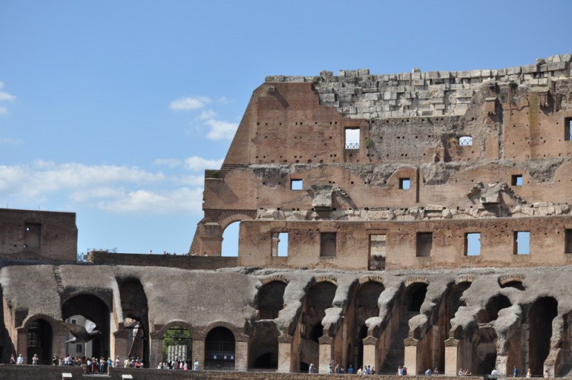 An image of the upper walls of the Roman Colosseum in Rome, Italy. Photography by Frame To Frame - Bob and Jean.