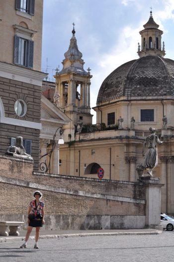Jean standing in Piazza del Popola square in Rome, Italy