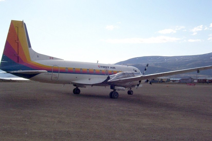 photograph of a First Air prop plane on the dirt runway in Pangnirtung on Baffin Island in Nunavut, Canada