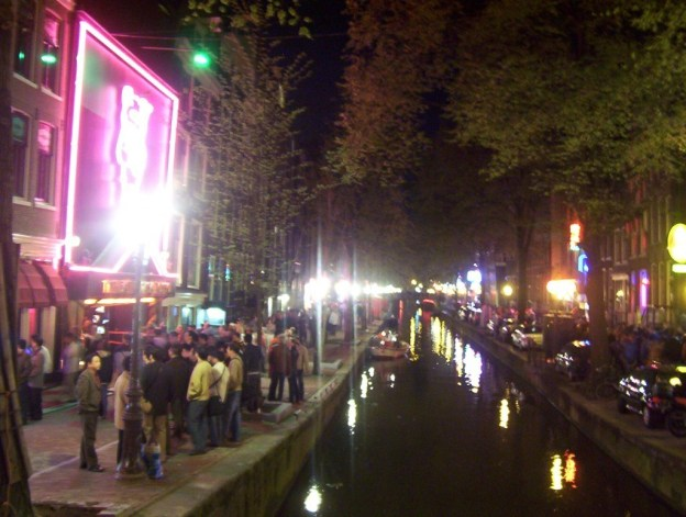 canal life at night in amsterdam
