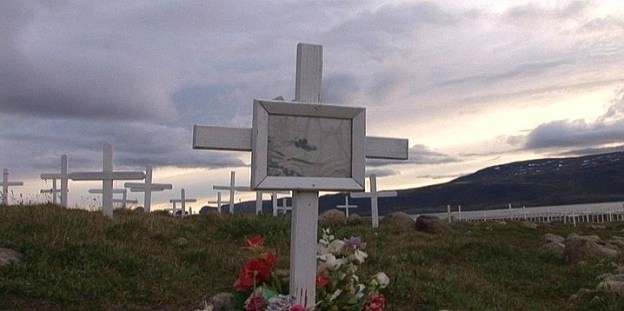 photograph of wooden crosses in the public cemetery in Pangnirtung on Baffin Island, Nunavut, Canada