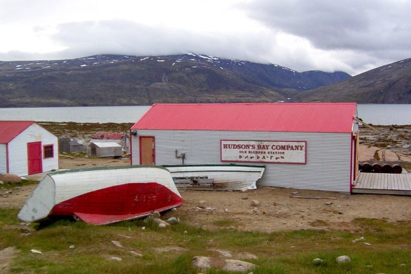 photograph of the former hudson's bay company blubber station buildings and boats in Pangnirtung on Baffin Island in Nunavut, Canada