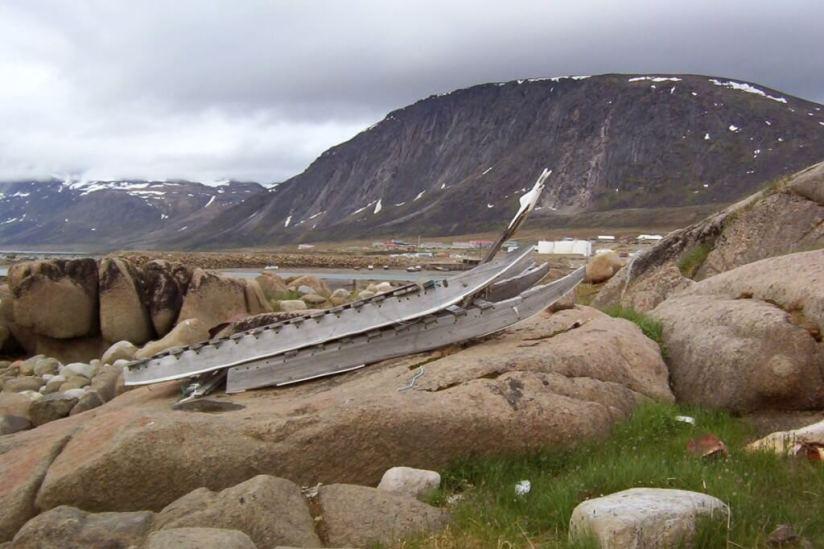 photograph of an inuit toboggan sitting on rocks in Pangnirtung, Nunavut, Canada.
