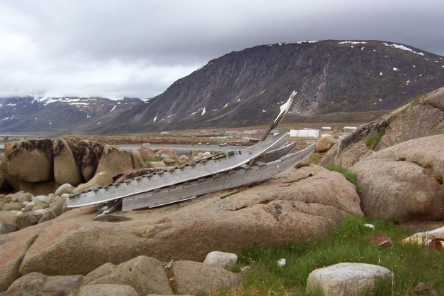photograph of an inuit toboggan sitting on rocks in Pangnirtung, Nunavut, Canada.