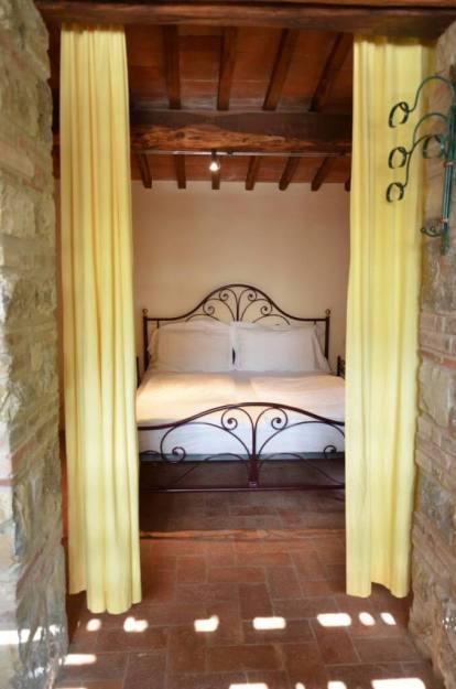 Bedroom in the stone farmhouse at Il Colombaio di Cencio, Gaiole, Chianti, Tuscany, Italy