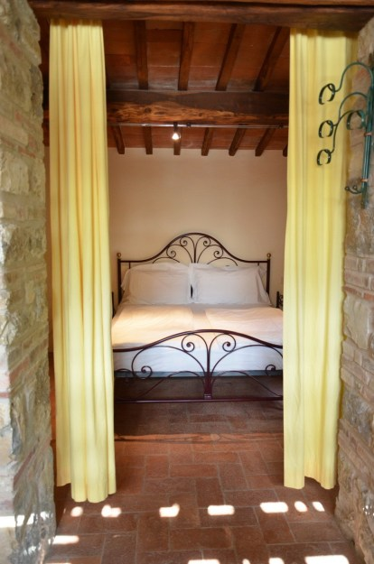 Bedroom in the stone farmhouse at Il Colombaio di Cencio, Gaiole, Chianti, Tuscany, Italy