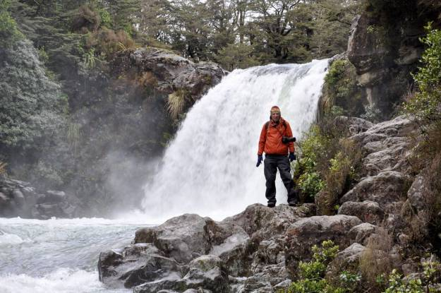 An image of Bob standing below Tawhai Falls in Tongariro National Park in New Zealand. Photography by Frame To Frame - Bob and Jean.