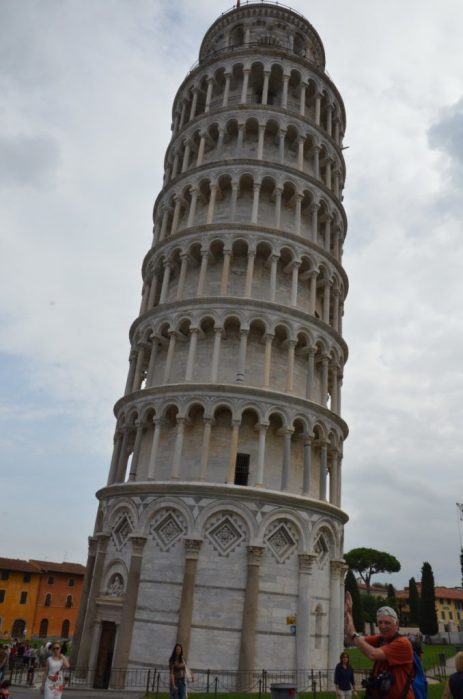 An image of bob pretending to hold up the Leaning Tower of Pisa in Tuscany, Italy. Photography by frame to frame - bob and jean.