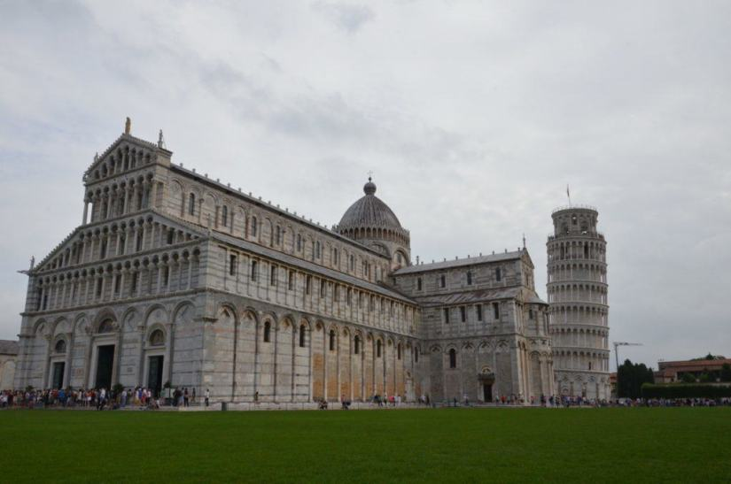 An image of the Pisa Cathedral with the Leaning Tower of Pisa behind it in Pisa, Italy. Photography by Frame To Frame - Bob and Jean