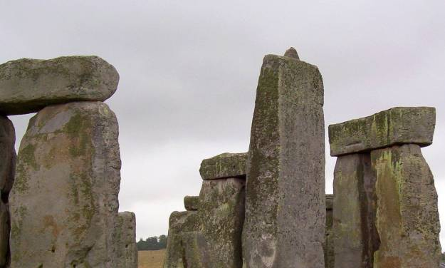 An image of the lintel stones on the top of the stone pillars at Stonehenge in Wiltshire, England.  Photography by Frame To Frame - Bob and Jean
