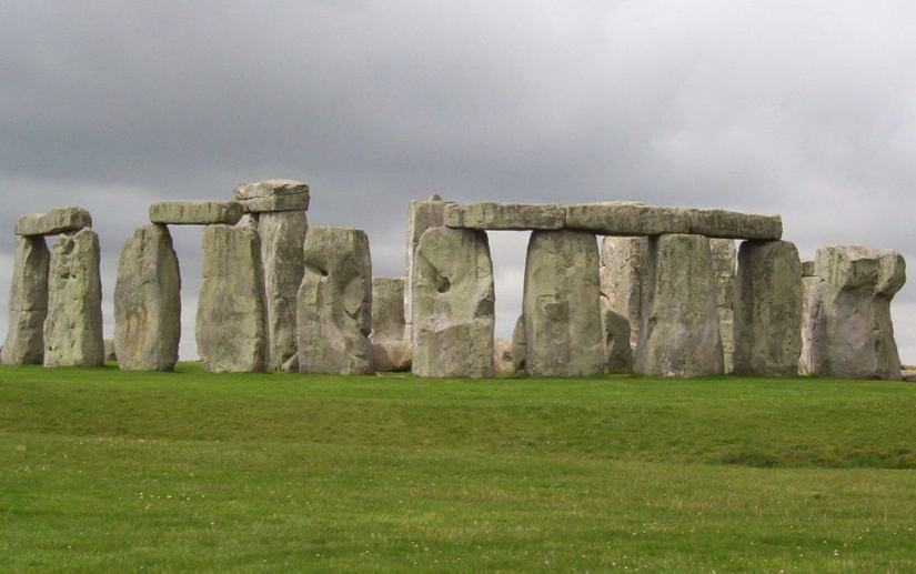 An image of several stone pillars holding up lintel stones on one side of Stonehenge in Wiltshire, England. Photography by Frame To Frame - Bob and Jean