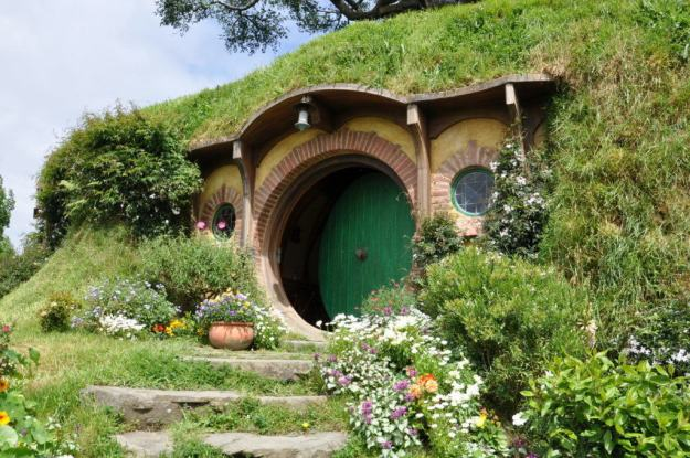 An image of the green door at Bilbo Baggins home on Bag End at Hobbiton in New Zealand. Photography by Frame To Frame - Bob and Jean.