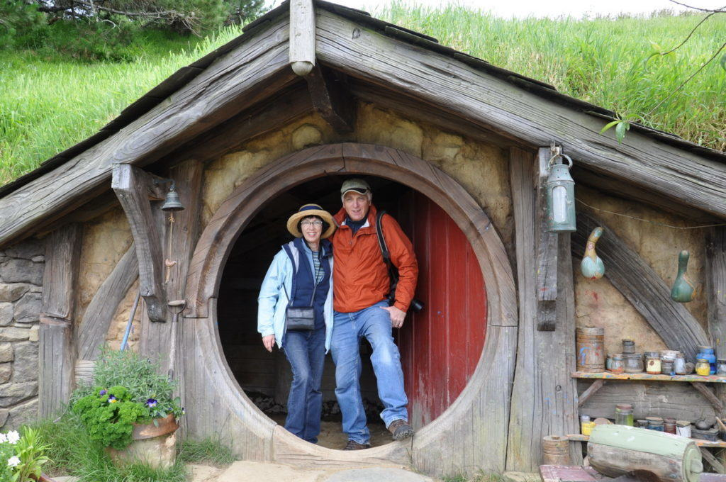 bob-and-jean-standing-in-the-gourd-artists-hobbit-hole-at-hobbiton-movie-set-new-zealand
