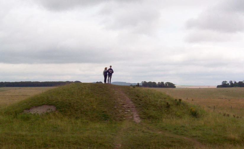 An image of Jean and blake standing on a mound near Stonehenge in Wiltshire, England. Photography by Frame To Frame - Bob and Jean