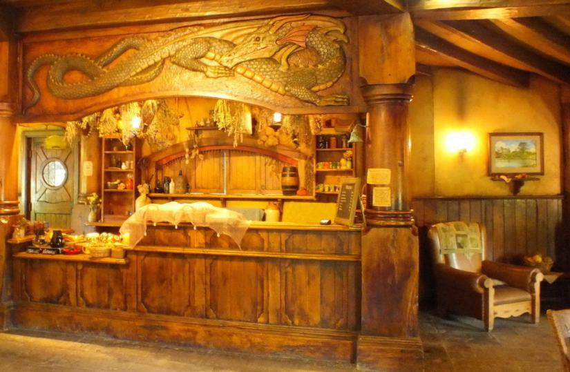 An image of the carved wooden green dragon inside the Green Dragon Pub at Hobbiton in Matamata, New Zealand. Photography by Frame To Frame - Bob and Jean
