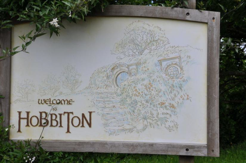 "An image of the ""welcome to hobbiton"" sign at Hobbiton in New Zealand. Photography by Frame To Frame - Bob and Jean."