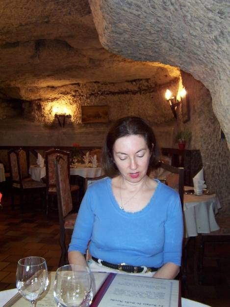 An image of Jean looking at a menu in Côté Cave Restaurant in Montlouis-Sur-Loire, France.