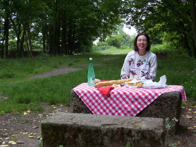 An image of Jean sitting at a picnic lunch near Giverny in France.