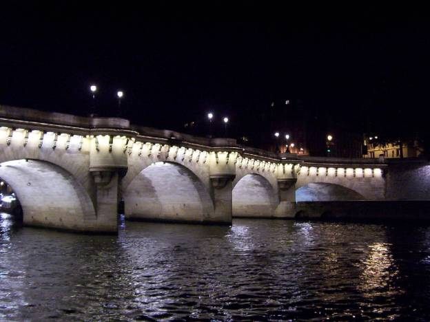 An image of Pont Neuf at night time in Paris, France.