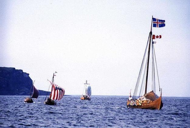 a reenactment of viking ships landing at l'anse aux meadows, newfoundland, canada