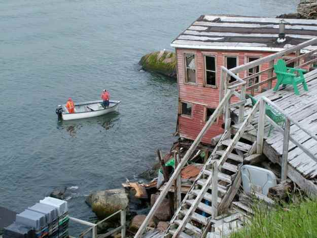 an image of damaged homes from the storm surge of 2010, St. John's, Newfoundland, Canada