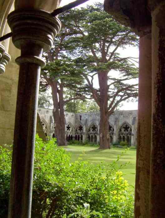 Image of the quadrangle through the cloisters at Salisbury Cathedral in England.