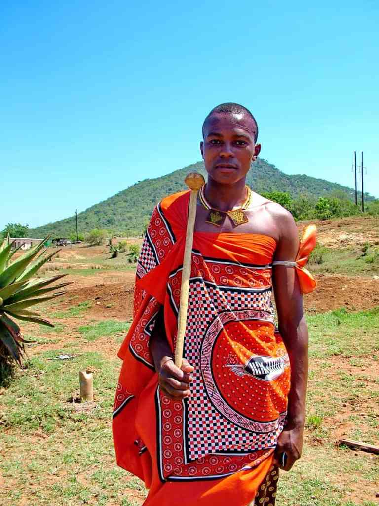 a young man in colourful traditional dress in swaziland, africa
