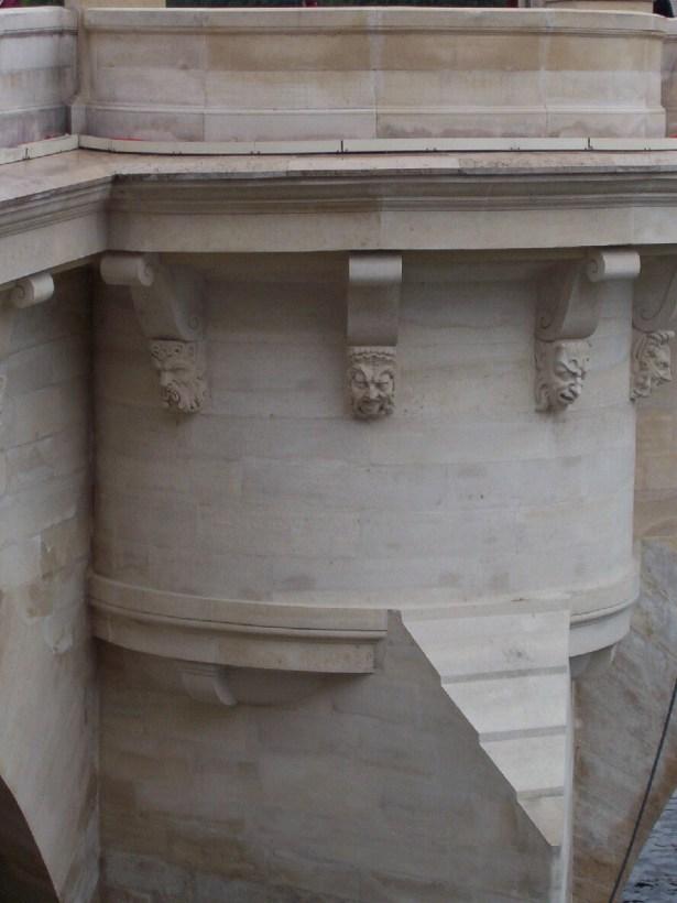 mascarons or masks on pont neuf, paris, france