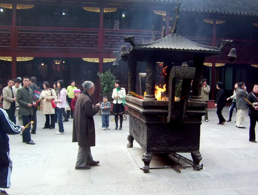 People standing around the altar outside the City God Temple of Shanghai