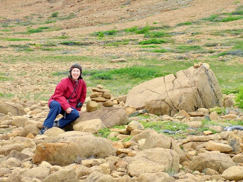 jean among peridotite rocks, the tablelands, newfoundland, canada