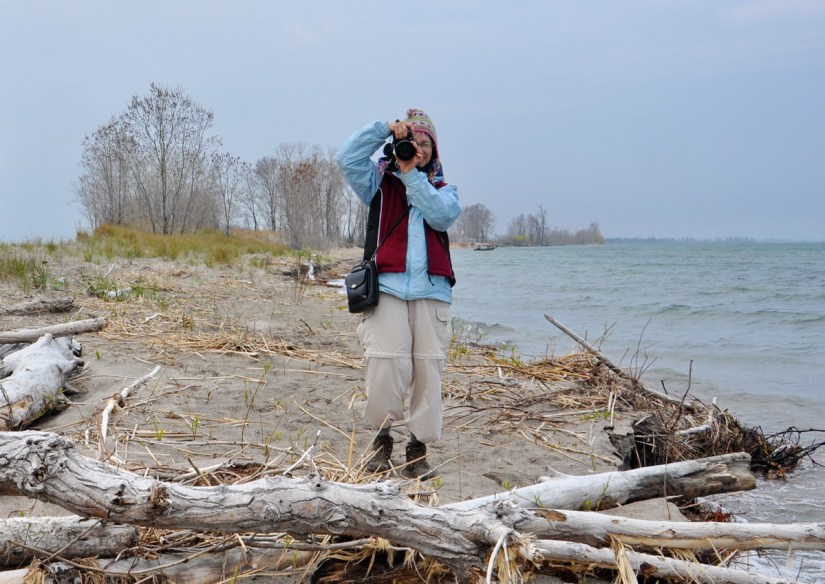 jean taking a photo at the tip of long point, lake erie, ontario