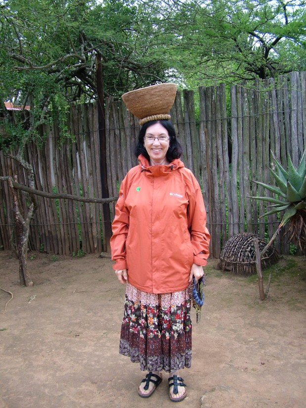jean with a woven basket on her head, shakaland, kwazulu-natal, south africa