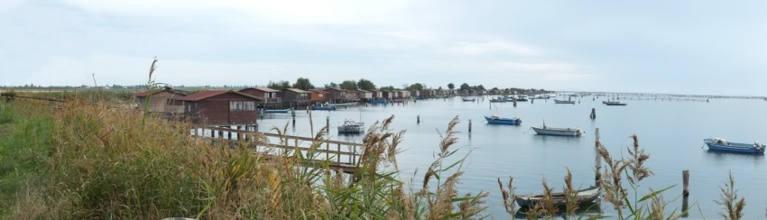 fishing houses along a fishing basin, po river delta, italy