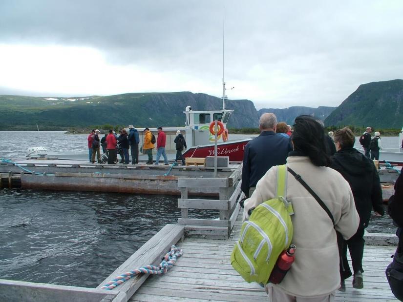 passengers boarding a tour boat, western brook pond, gros morne national park, newfoundland, canada