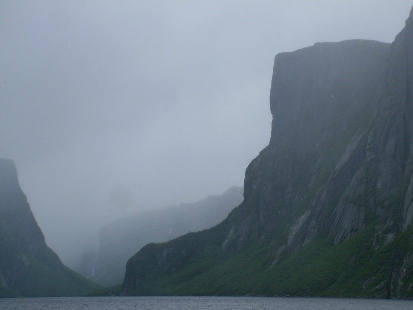 eerily foggy western brook pond, gros morne national park, newfoundland, canada