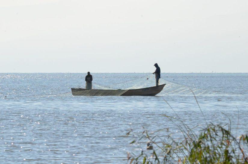 fishermen setting nets, lake chapala, mexico