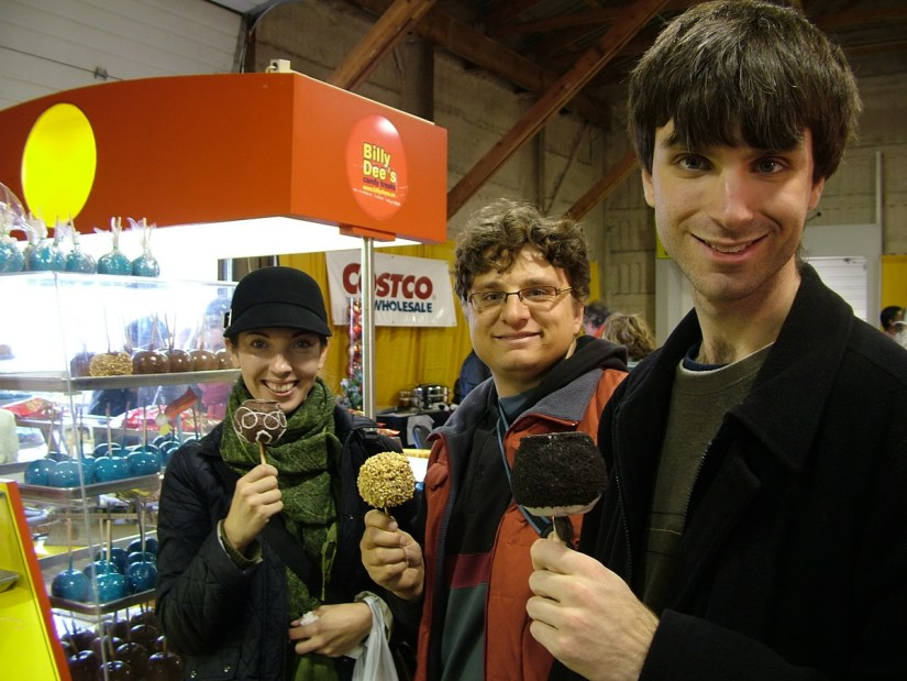 people eating candy apples, markham fair, markham, ontario, 2009