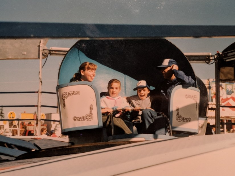 family riding the Tilt-a-whirl, markham fair, early 1990s