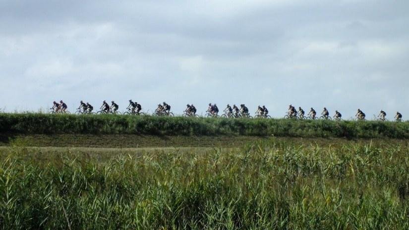 cyclists, reno river, sant'alberto, italy