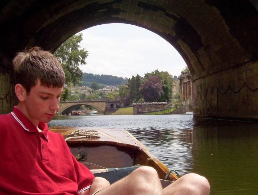 a punt at pulteney bridge, bath, england