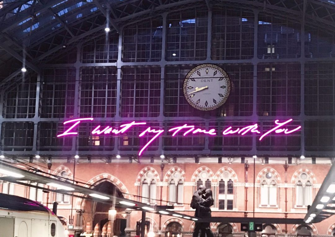 A neon pink sign at King's Cross St Pancras reading 'I want my time with you' A row of Parisian houses on Monmarte in day trip to Paris on a budget on francescasophia.co.uk