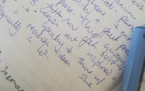 handwriting and a pen