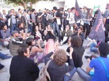 Anarchists sit down, chant, at end of march in entry to Zone A; 29 March 2013; photograph by Frances Hasso