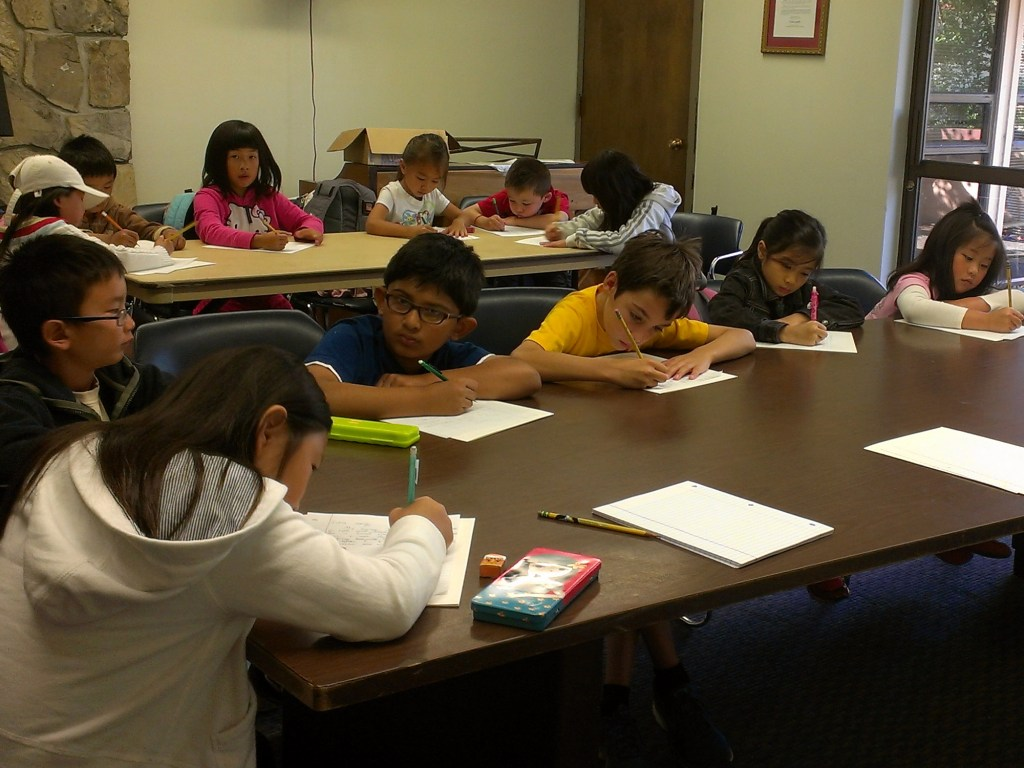 young students writing