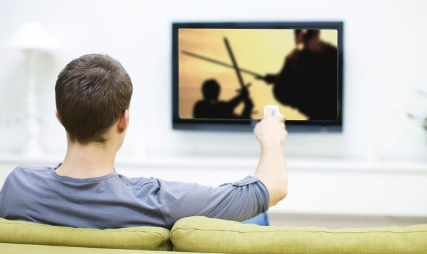 Man watching football on television