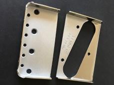 Genuine Fender bridge plate sawn in two