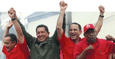 El nuevo ministro de ciencia Jesse Chacón en la mano izquierda de Chávez. (C) Science.